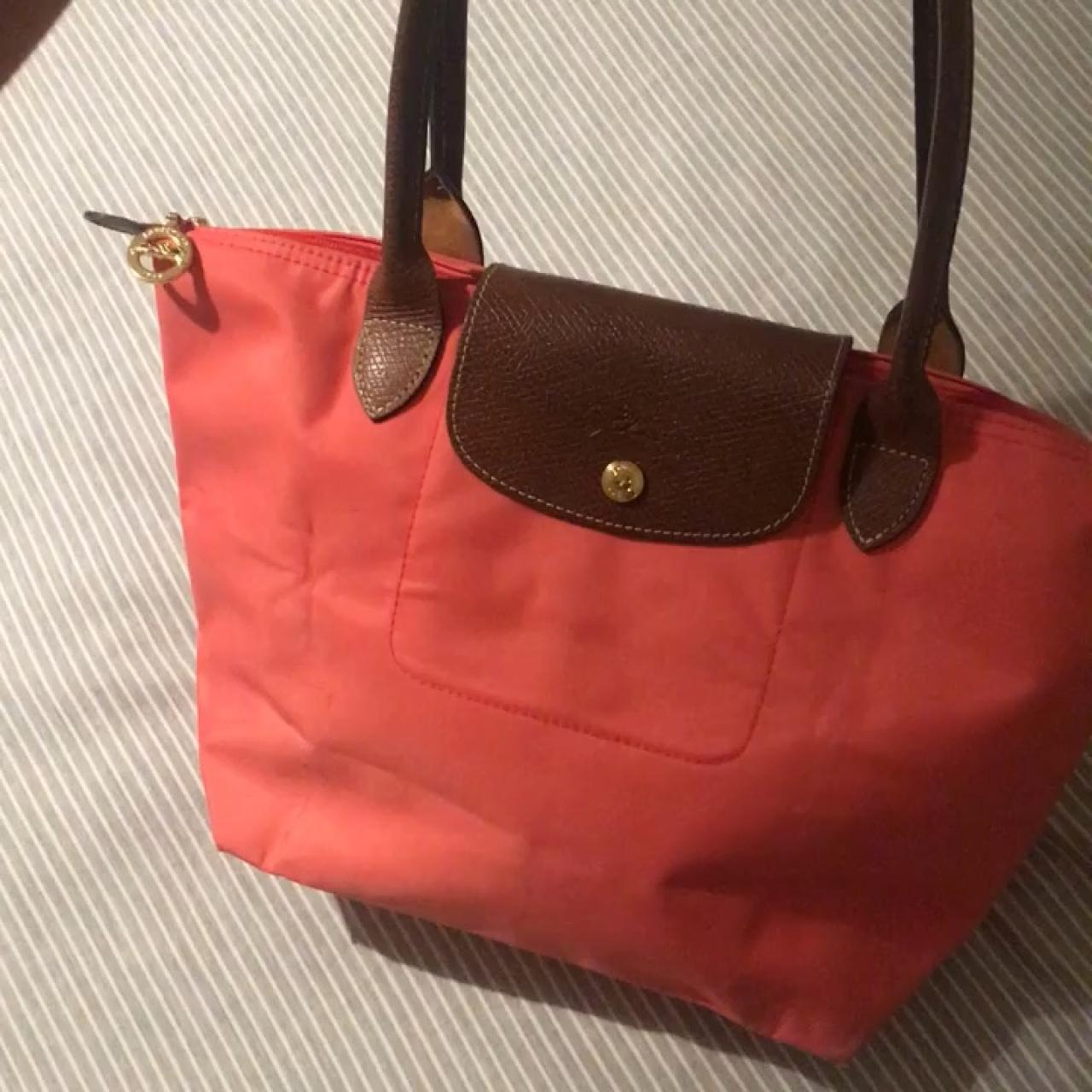 cc8496258320 Longchamp le pliage bag in coral. Worn but in good condition - Depop