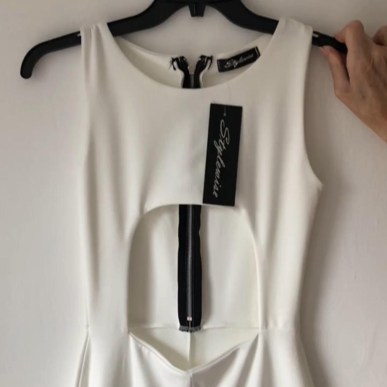 68b7587209a Underboob white jumpsuit. Zip fastening at back. Stretch . - Depop